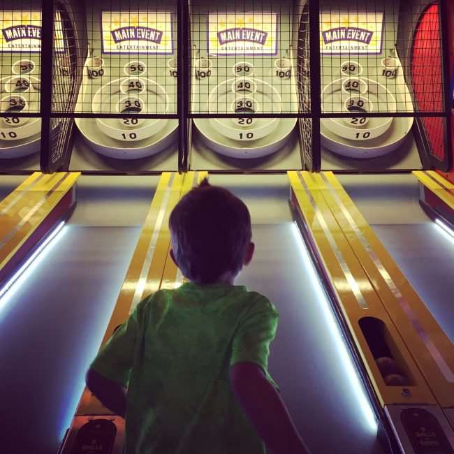 Skeeball is a classic game - Play it and other games by scheduling a Main Event Birthday Party - Kid friendly and so much fun - #Funstigators