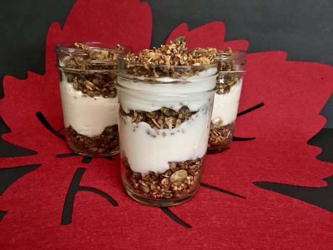 Gluten Free Pumpkin Spiced Granola Parfaits - These simple yogurt parfaits are made with vanilla yogurt and pumpkin spice yogurt. Simple and delicious way to snack happy or start the day with a great breakfast