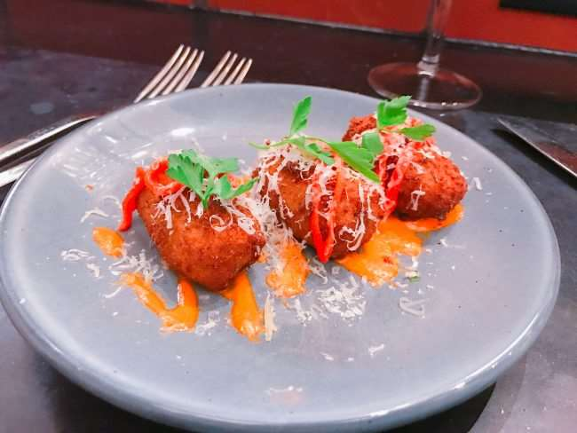 Meril's in the Warehouse District has amazing food like these Spanish Croquettes - Eat Your Way Around New Orleans and taste how diverse the city's culinary scene is. If you are traveling to NOLA check out these restaurants we visited on a recent trip and are sure to go back to again and again