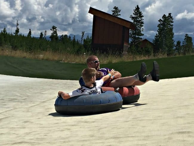 Summer tubing at YMCA of Rockies Snow Mountain Ranch. Just like snow tubing only in shorts. Fun for the whole family! Awesome mountain views and a magic carpet ride back up the hill to save your oxygen! Part of the YMCA Snow Mountain Ranch Family Fun Park. Come an play all day!
