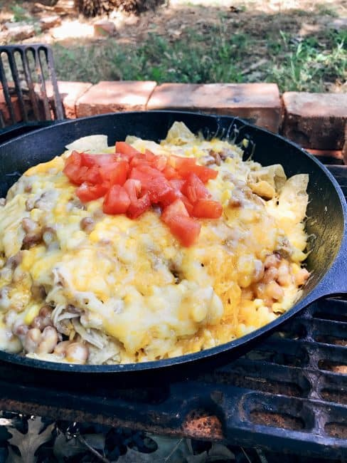Make anywhere Campfire Nachos with green Chile chicken, beans, and corn.