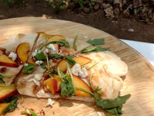 Peach & Honey Pizza made in an outdoor CampMaid Dutch Oven